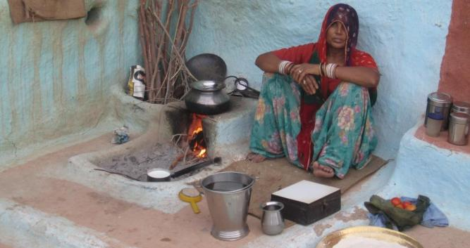 Local lady cooking over the fire, Rohet, India