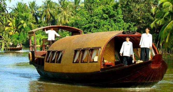 Crew onboard the Song Xanh Sampan, Mekong Delta, Vietnam