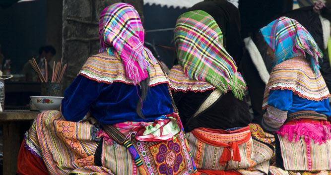 Ladies in traditional hilltribe dress at the markets, Bac Ha, Vietnam