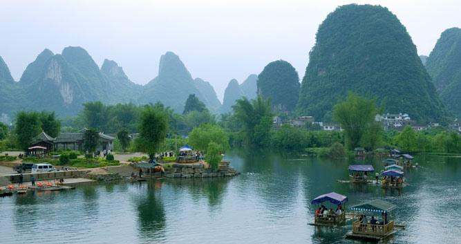 Bamboo boats on Li River, Yangshuo, near Guilin in Luxury Travel China