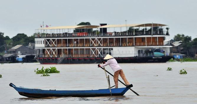 Local man rowing down the Mekong, Pandaw Cruise, Vietnam