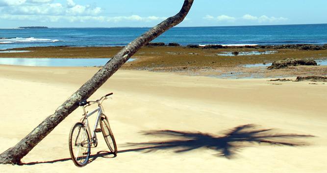 Cycling along the beach, Marau Peninsula, Brazil