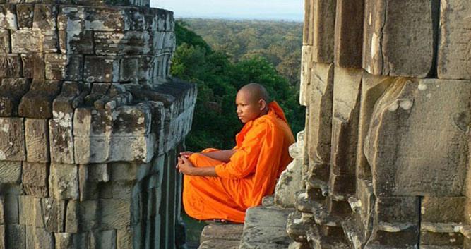 Monk reflecting at Angkor Wat, Siem Reap, Cambodia