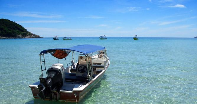 Boat floating in the clear sea, Perhentian Islands, Malaysia