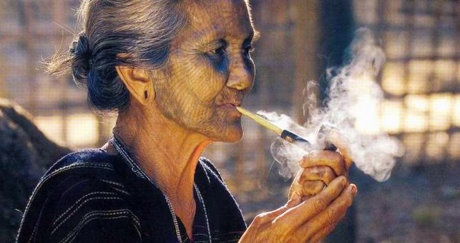 Village lady smoking a pipe, Burma